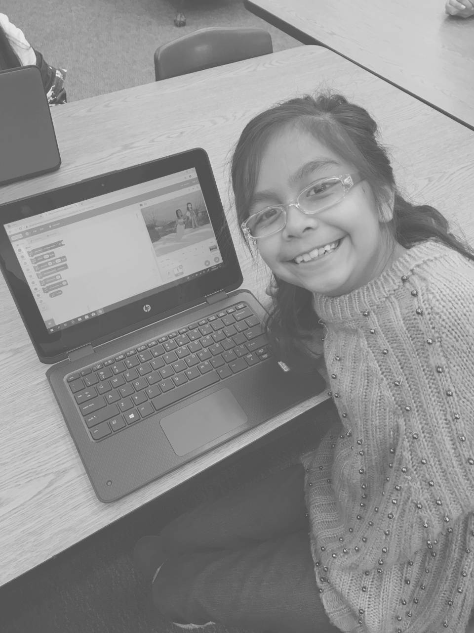 Girl smiling showing what she coded in Code.org